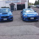 two blue cars